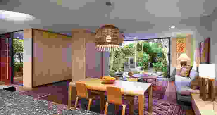 The architects' solution to the original clutter includes an expanded breakfast/family area that opens onto the garden.