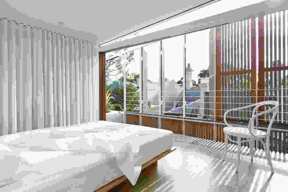 Shutters and curtains in House 2's main bedroom allow inhabitants to enjoy or shelter from the weather.
