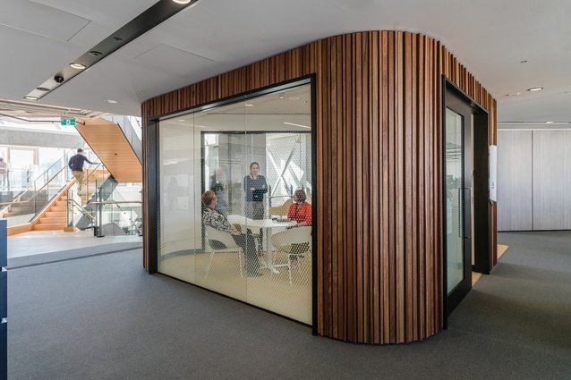 Old plant rooms that were located at the core of the building have been turned into highly visible meeting rooms facing the atrium.