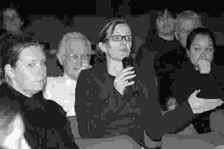 Tracey Avery asks a question from the audience.