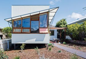 Rather than demolish the original cottage, the designers and their clients opted to refresh it with an extension that addresses the street and landscape.