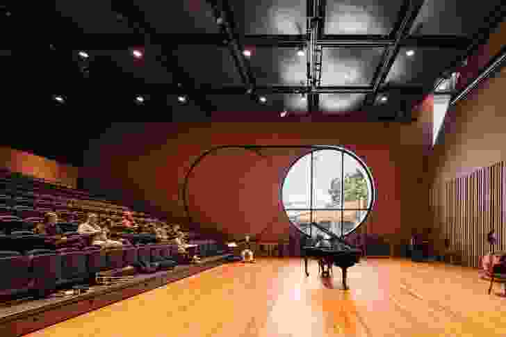 The oculus window makes public the inner realm of music practice and education.