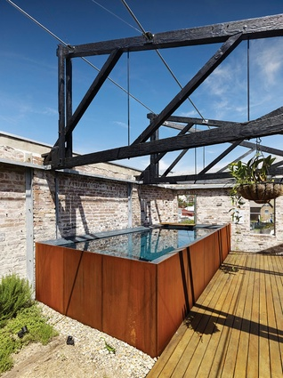 Plunge pool made of Corten steel at Lilyfield Warehouse.