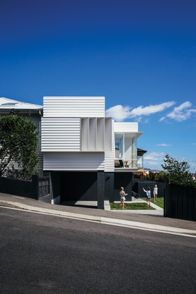 "The ""unashamedly contemporary"" living level continues the building lines and the weatherboard cladding of the existing house."