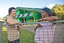 Deborah Fisher with Cheryl Graham outside her Yarrabah home.