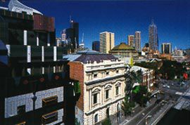 Swanston Street, with RMIT's Building 8, by Edmond and Corrigan, and Storey Hall by Ashton Raggatt McDougall. Image: John Gollings.