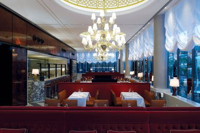 The six-metre-high ceilings are punctuated with glittering chandeliers.
