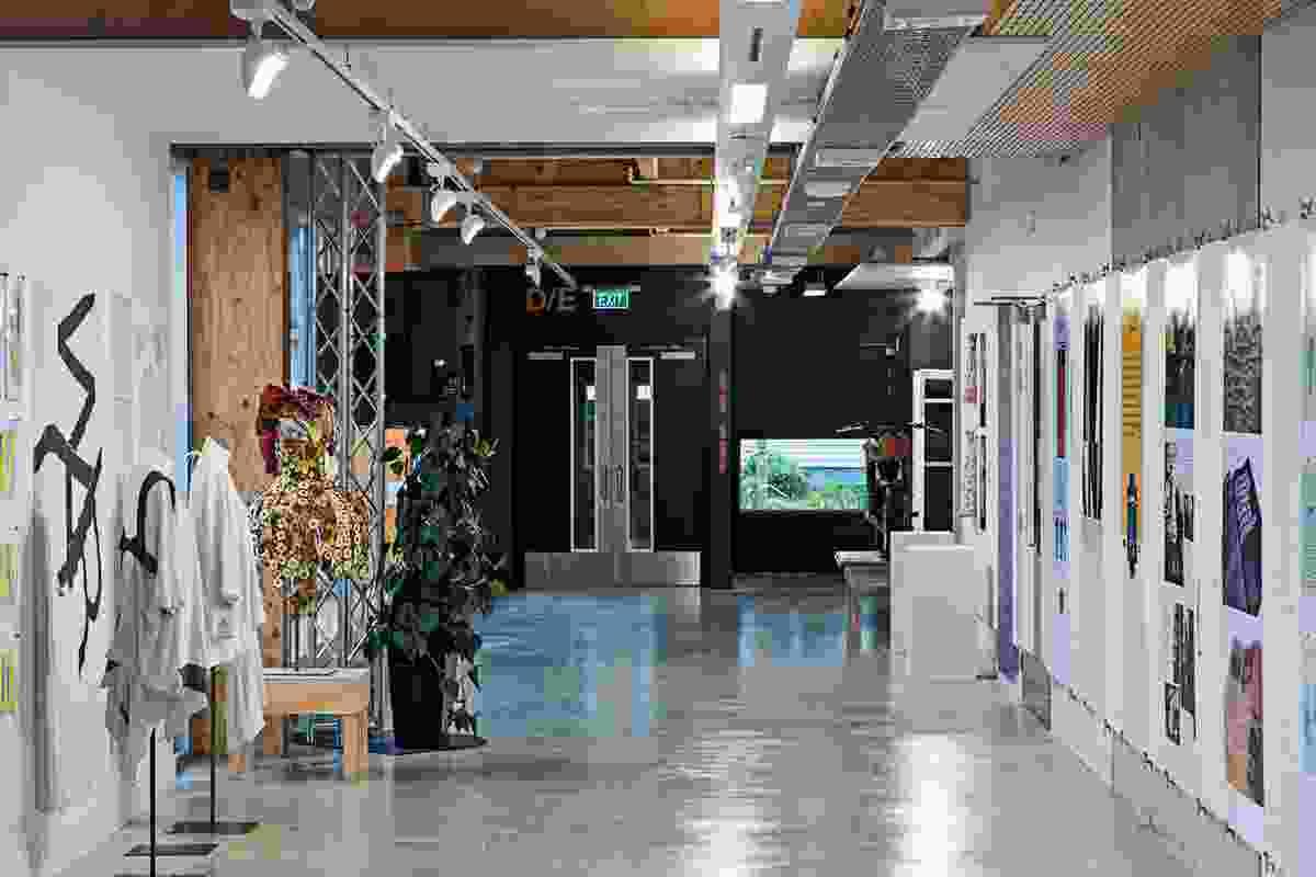 A wide corridor doubles as an exhibition space.
