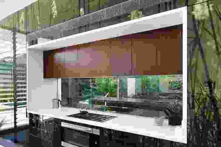 A horizontal window acts as a splashback for the kitchen bench.