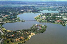 Aerial view showing Acton Peninsula and the museum within Canberra's wider landscape.