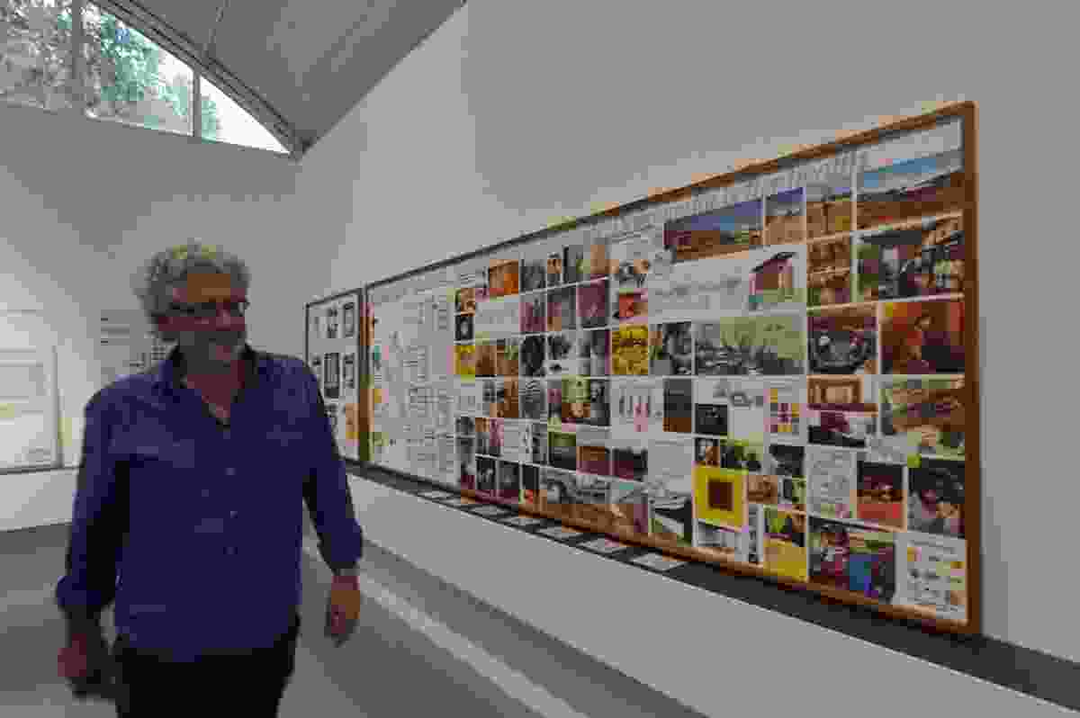 Paul Pholeros runs his eye over storyboards for the Healthabitat exhibit.