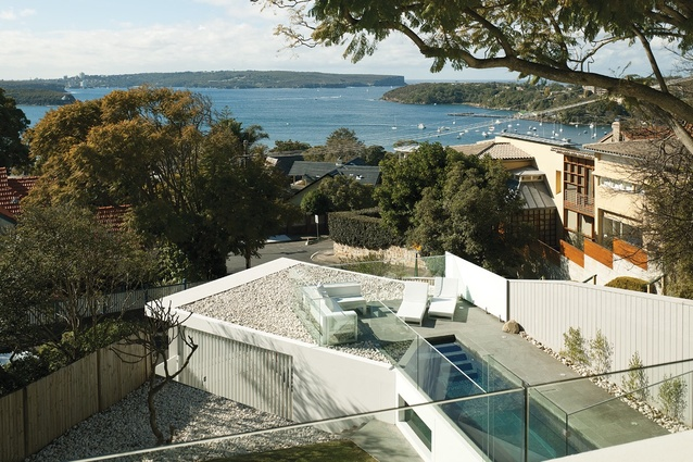 The Swimming Pool And Deck Anchored Into The Slope