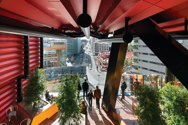 "The view from a portal space towards the kink in Swanston Street, the Hardrock indoor rock-climbing centre, Design Hub and the ""federation freestyle"" of the Melbourne City Baths"