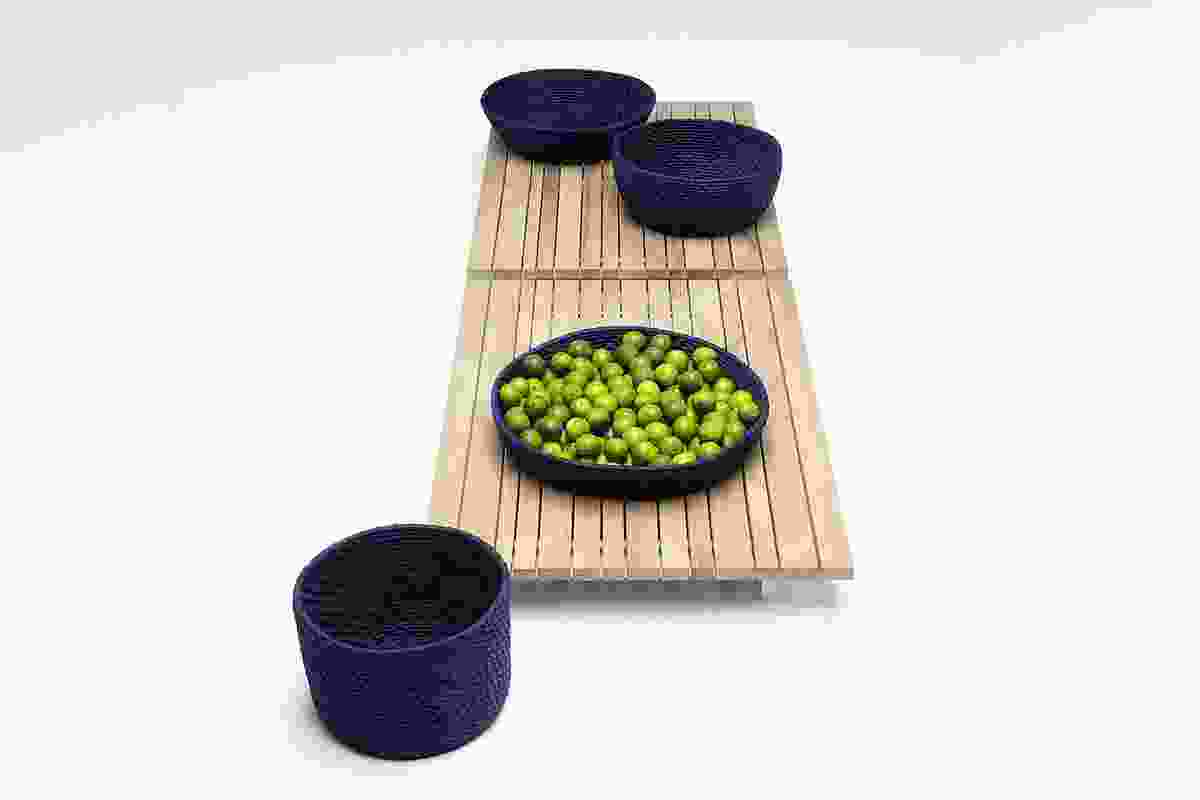 The Marelle is a felt outdoor rug, seen here with the Picot pouf.