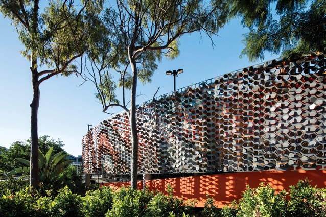 The Robina Town Centre's carpark is now cloaked in a textural screen by Urban Art Projects, comprising laser-cut and folded metal panels.