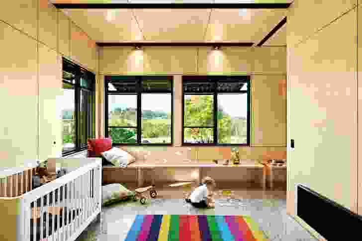 A pair of red, highly theatrical motorized curtains converts the free-form space into bedrooms in the Kids Pod by Mihaly Slocombe.