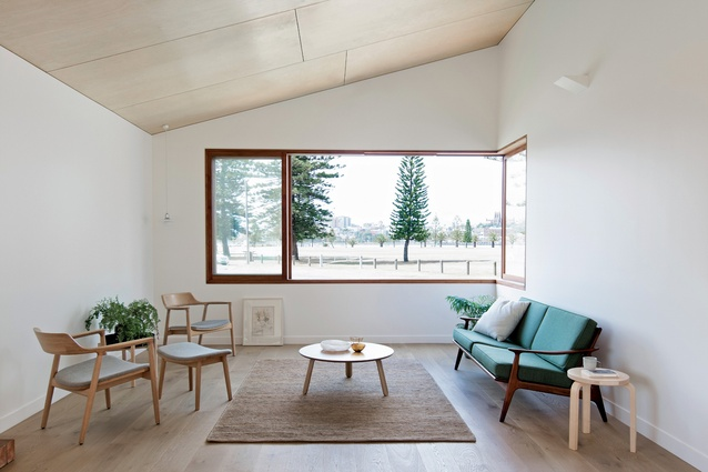 Interior spaces encourage activity at the home's periphery, strengthening the connection with the site.