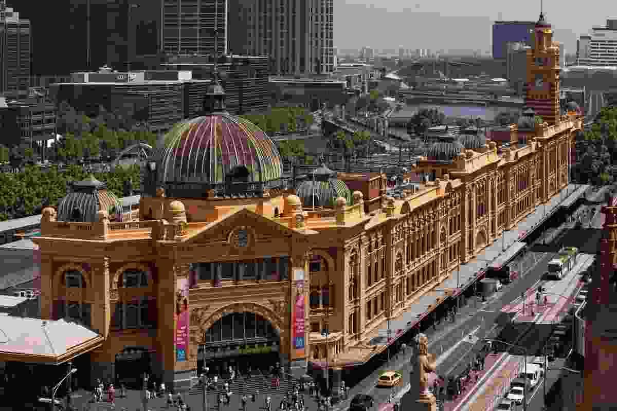Flinders Street Station bounding Flinders and Swanston streets.
