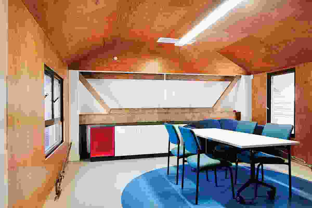 Women's Health and Family Services. CODA's engagement with the domestic and institutional can be found in the play of scale and material in the cladding, such as the rough-sawn timber used in this meeting room.