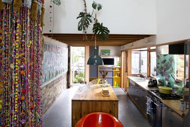 The kitchen with Marmoleum floor, and  recycled brick wall.