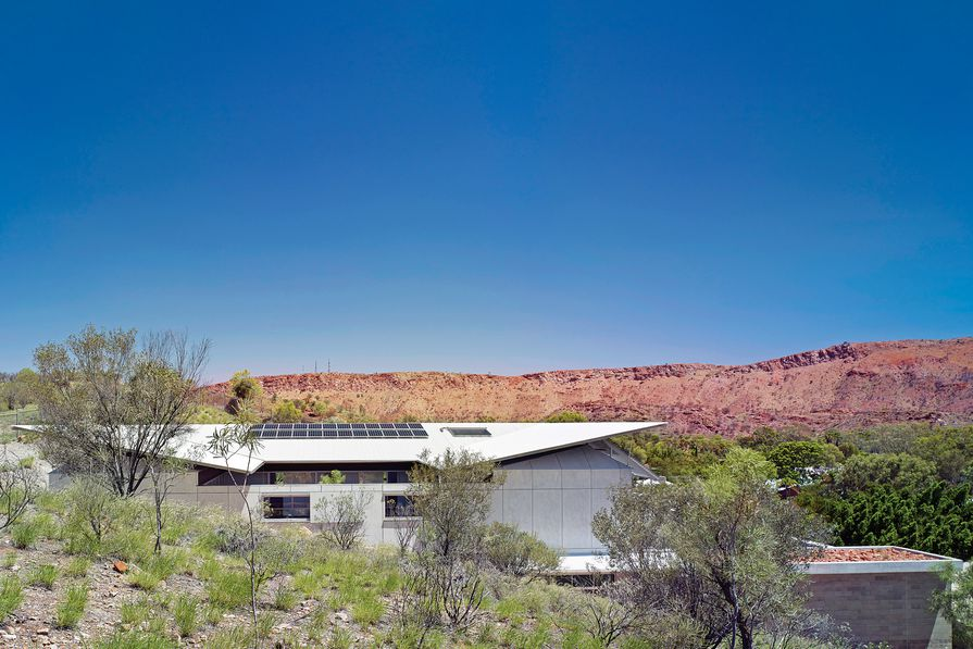 The Desert House opens to the west, where it confronts the surreal scale of the West MacDonnell Ranges.