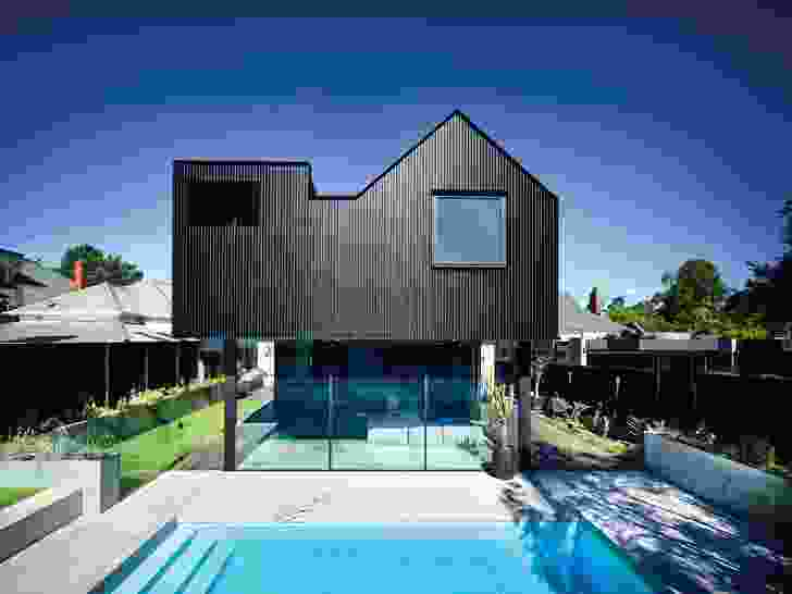 The floating silhouette of the rear elevation emphasizes the fortified privacy of upstairs and the openness of downstairs.