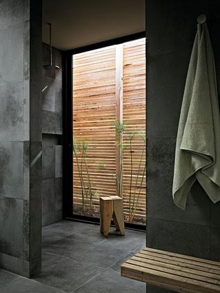 The bluestone flooring continues into the bathroom areas.
