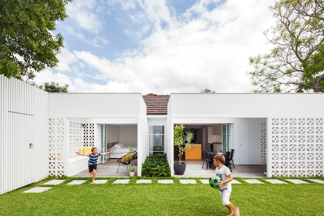 A Gentle But Dramatic Transformation Has Taken Place At The Rear Of A Red Brick  Home