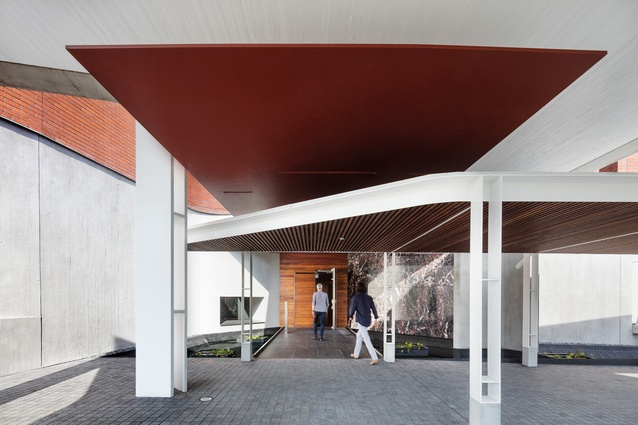 The front door to the chancery is defined by the angular planes of the pedestrian walkway at its conjunction with the porte-cochere.