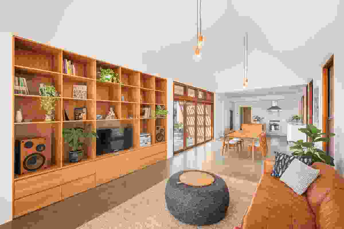 The living area's contemporary inbuilt joinery unit, which was designed by the clients, is as visually appealing as it is functional.