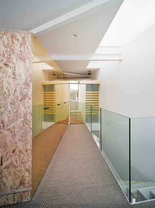 The corridor to the bathroom on the upper level is lined with reflective gold facing.