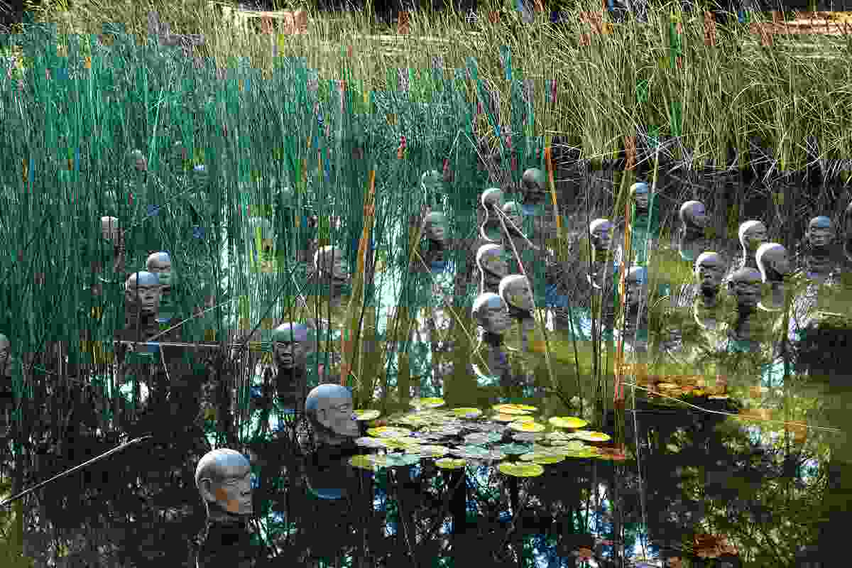 Dadang Christanto's Heads from the North (2004) in a marsh pond.