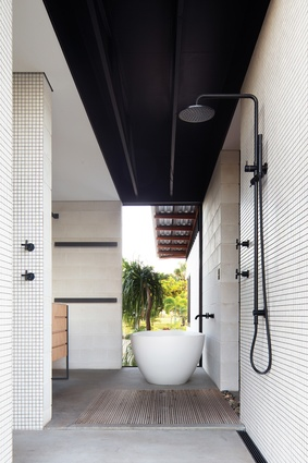 The indoor/outdoor bathroom is an inviting space that offers calming natural light and views of greenery.