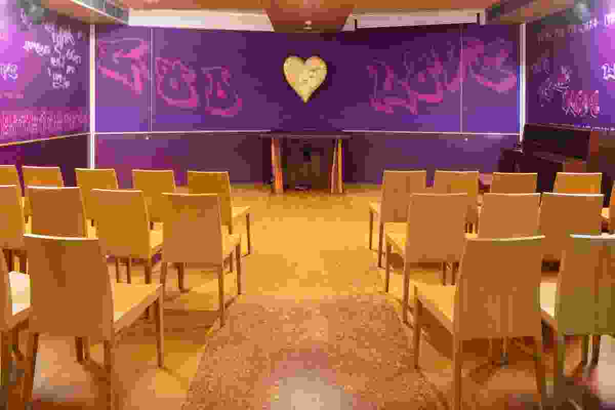 "A small chapel on the ground floor, behind the cafe, provides a non- denominational sanctuary for an organization with the motto ""love over hate."""