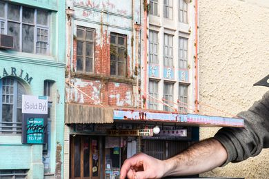 """In Urban Decay, miniaturist Joshua Smith depicts """"overlooked"""" buildings from across Sydney, including the Karim Building on Wentworth Avenue, the Olympia Milk Bar on Parramatta Road, and the Chinese Ginsengs and Herbs Co. building in Haymarket."""