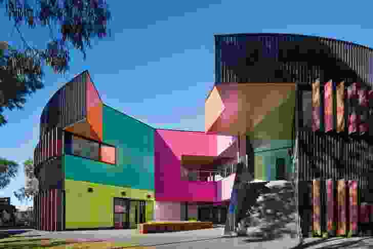 """MCR's design for Ivanhoe Grammar School (2015) showcases flexible learning spaces housed in a radial form that is broken by """"an eruption of colourful and chaotic forms."""""""