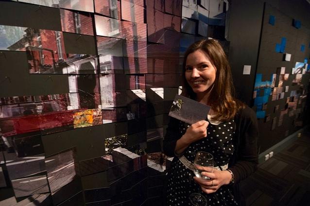 Lucy Fuchsbichler choosing a postcard from the piece <em>Home?</em>