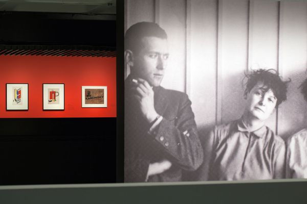 Large-scale projection of an archival photograph of Marcel Bruer with Martha Erps.