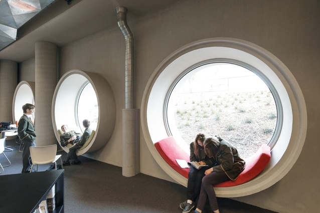 Porthole windows on the south facade provide whimsical window seats in the lounge area.