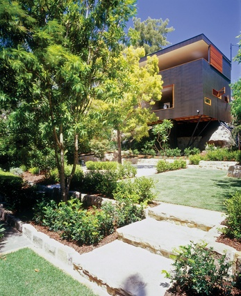 "The two-storey black cube ""created a slightly alien presence in the garden,"" but it cleverly connects a series of pathways, trees and topography across the site."