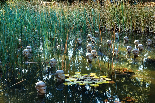 Dadang Christanto's <em>Heads from the North</em> (2004) in a marsh pond.