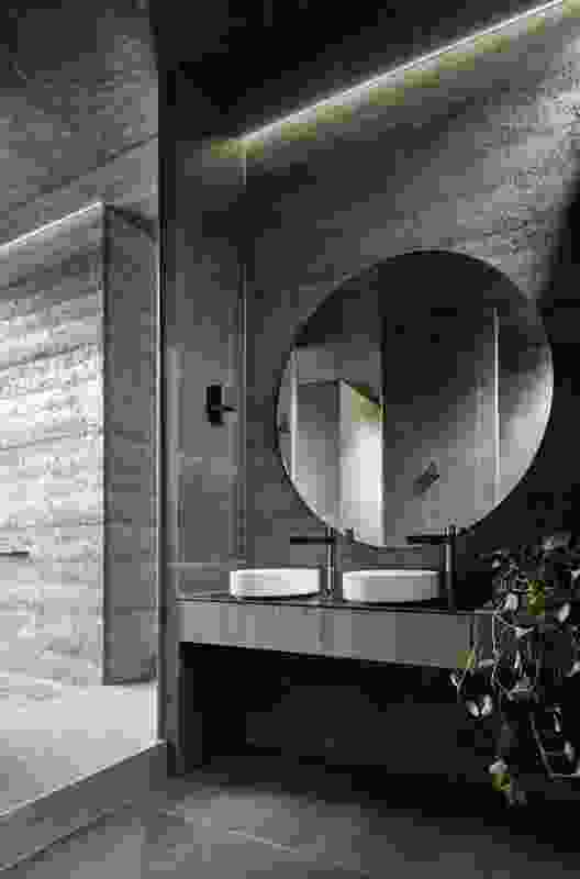 The ensuite is split into two parts, with basins and an indoor shower at the northern side.