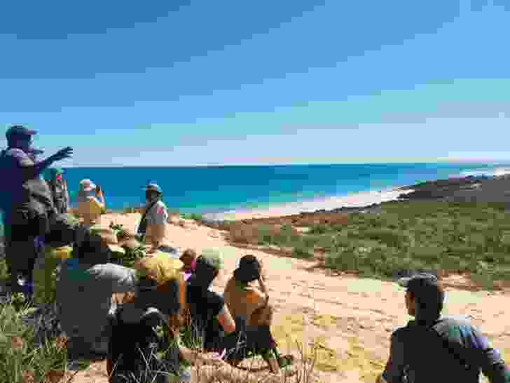 Participants walk the beaches and dunes accompanied by community members who unfold the stories of the landscape along the way.