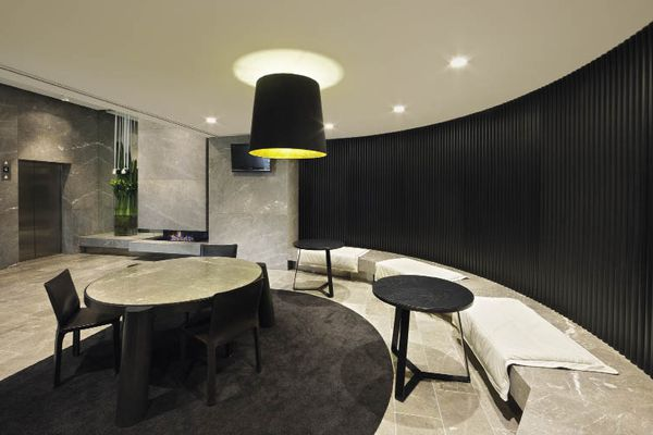 The curved meeting room in the lift lobby is more like the lobby of a boutique hotel.