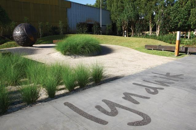 The sculptural landscape includes graphic elements.