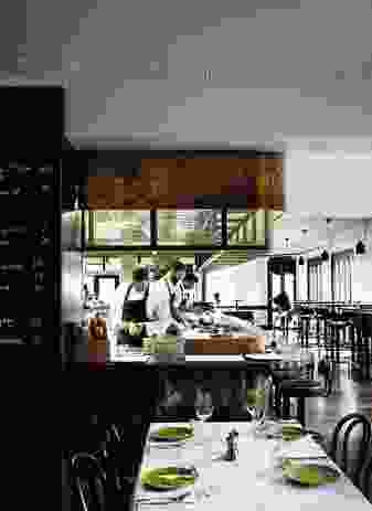 """At the centre of the space, the expansive open kitchen places chefs in front of the diners so they can """"almost cook on your plate."""""""