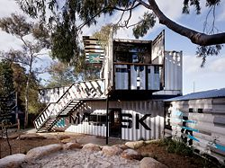 The particular qualities of the four shipping containers are retained and enhanced to form the Activity Centre.