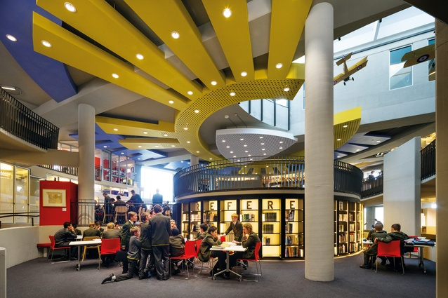 Inside, the centre unravels as a series of platforms and contours encircling a drum of reference shelving.