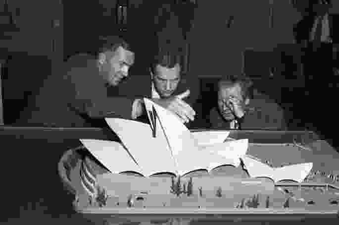 Jørn Utzon (left) presenting a model of the Opera House at Sydney Town Hall, 1957.