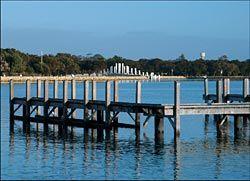 The memorial seen across the estuary. Photographs Hames Sharley.